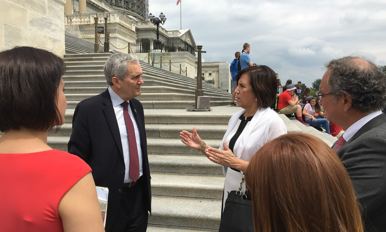 Maria Lopez De Leon meets with Rep. Lloyd Doggett on the steps of the Capitol