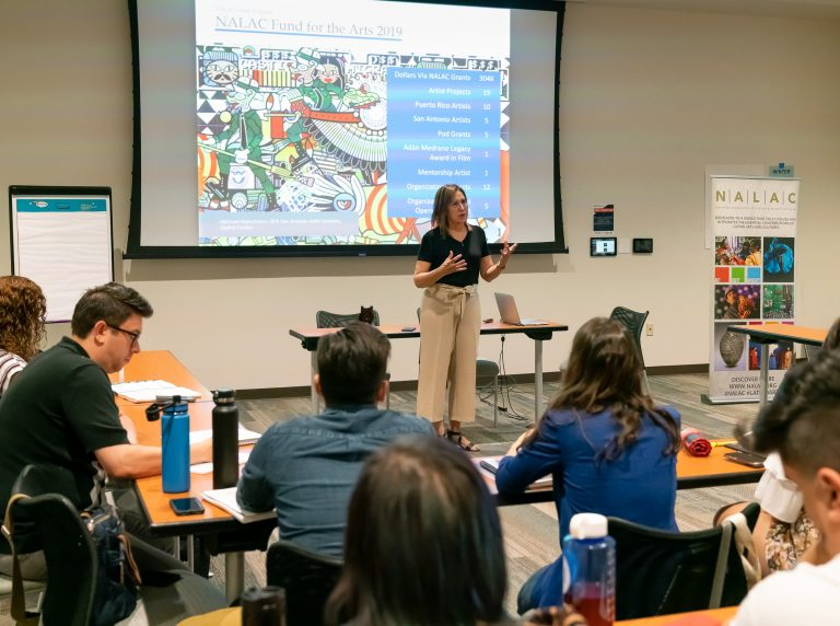 María López De León welcomes the 19th NALAC Leadership Insitute cohort in opening remarks at UTSA Downtown Campus Durango Building.