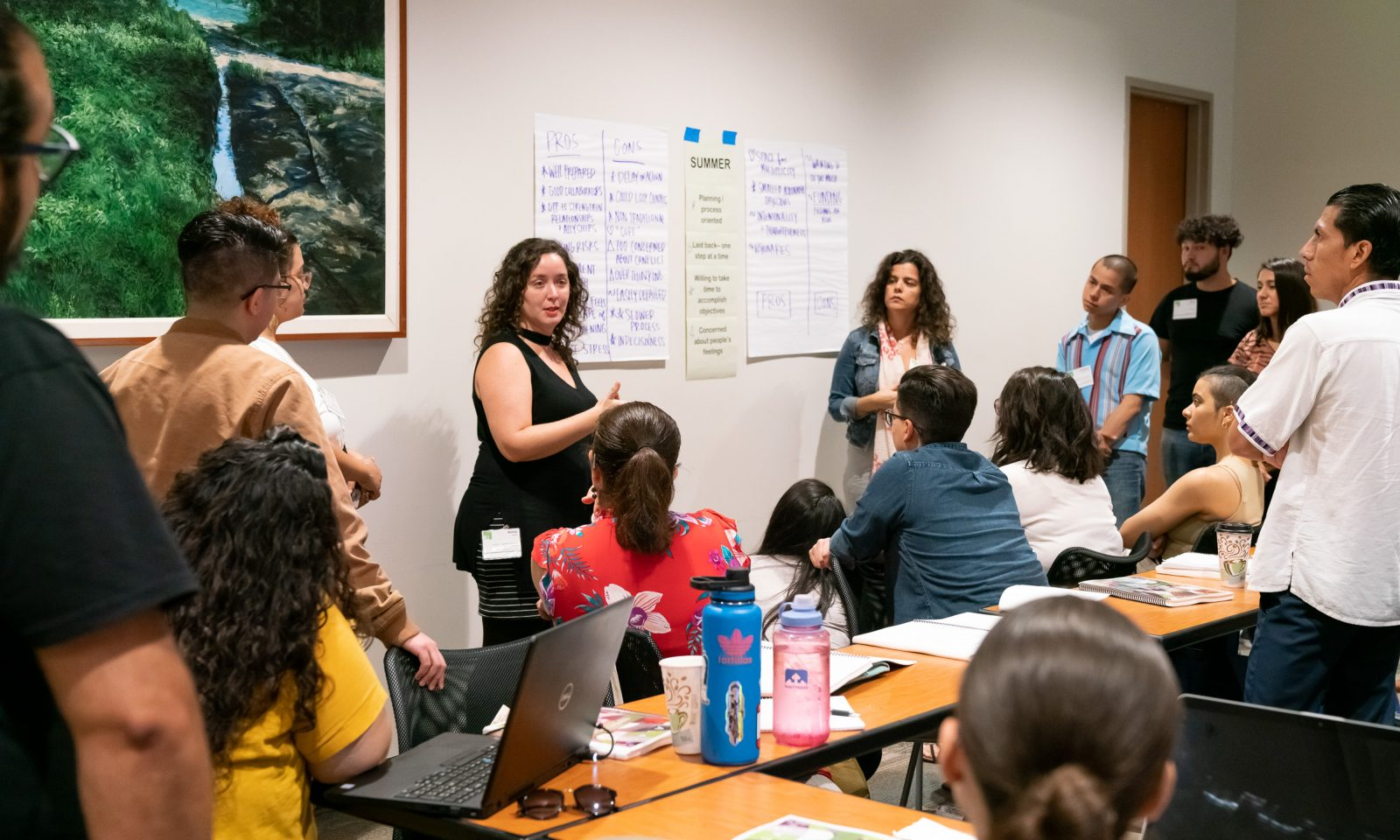 "NLI participant fellow Annie Y. Saldaña Matías (center left), addresses fellows on the question of ""Leadership Style"" during institute session."