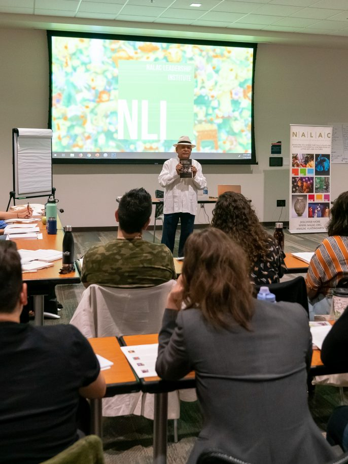 """Tomás Ybarra-Frausto speaks to the 2019 NLI class during his session titled """"No Llegamos Ayer, y No Nos Vamos Mañana"""""""